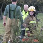 Firefighters man a hydrant while crews battle a blaze caused by an unattended frypan in Roxburgh...