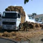 Firefighters try to put out a fire in straw on the back of a truck in Airedale Rd, Weston,...