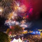Fireworks light up the sky to celebrate the opening of the Queenstown Winter Festival as...