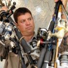 Fish and Game Otago operations manager Ian Hadland with an armload of gear recently seized from...