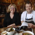 Fleur Sullivan and head chef Simon Peacock look through their copy of Fleurs Place, by Graham...