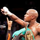 Floyd Mayweather Jr. of the US celebrates his victory over WBC welterweight champion Victor Ortiz...