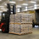 Fonterra forklift driver Shane Priest unloads milk powder from a train at the company's North...