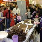 Food artist Prudence Staite demonstrates her chocolate food art at the Meridian Mall on Saturday....