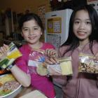 Forbury School pupils Charlene Phuong (left) and Lily Young (both 10) in the school's new kitchen...