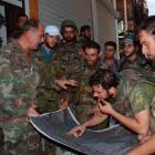 Forces loyal to President Bashar al-Assad look at a map at Suleiman al-Halabi neighbourhood in...