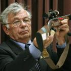Forensic Scientist Peter Hentschel giving evidence, handling the murder weapon, at David Bain's...