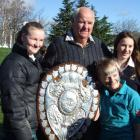 Former All Black and Otago player Don Clark with granddaughters (from left) Tia (12), Kesley (10)...
