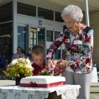 Former Awamangu School ex-pupil Gwen Treacy (91) and Clutha Valley Primary School pupil Toby...