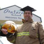 Former firefighter Mike Stanley prepares for his new life as a teacher at Otatara School, near...