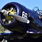 Former Harvard pilot George Hurst inspects a 1943 Harvard aircraft in Mosgiel. Photo by Peter...