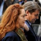 Former News International chief executive Rebekah Brooks and her husband Charlie Brooks arrive at...