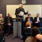 Forum convener Prof Kevin Clements (standing) speaks  at a joint health board/mayoralty forum,...