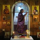 Fr Carl Somers-Edgar swings an incense burner inside St Michael's Greek Orthodox Church of...