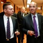 France's Finance Minister Pierre Moscovici (R) talks to his Greek counterpart Yannis Stournaras...