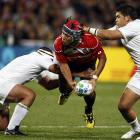 France's Jean-Baptiste Poux and Raphael Lakafia tackle Japan's Shota Horie during their Rugby...