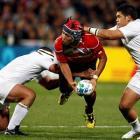 France's Jean-Baptiste Poux (L) and Raphael Lakafia (R) tackle Japan's Shota Horie during their...