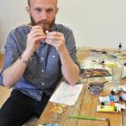 Frances Hodgkins fellow 2014 Patrick Lundberg paints pins for one of his works. Photos by Linda...