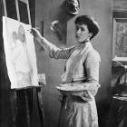 Frances Hodgkins paints at an easel in her Bowen St studio, c.1905. Photo from Alexander Turnbull...