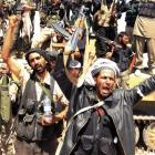 Free Syrian Army fighters rejoice after seizing the town of Khanasir, a strategic town in...
