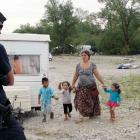 French CRS police stand in an illegal camp housing about 114 Romaas they start to evacuate...
