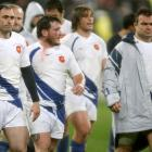French players leave the field dejected after their loss against New Zealand in the international...