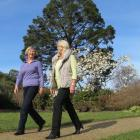 Friends of the Dunedin Botanic Garden tour guides founder Annette Riley (left) and new co...