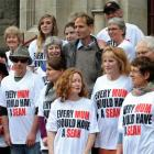 Friends support  Sean Davison (centre)  outside the Dunedin District Court yesterday. Inset, top,...
