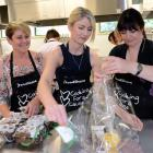 From left, Firebrand owner Rebecca Twemlow helps Firebrand employee Kate Boreham and accountant...