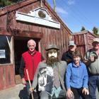 "From left, John Hore, ""Wally"" (holding a photograph of blacksmith Nicol Muirden), Burns Pollock,..."