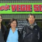 From left, Melinda, Suzie, Reggie and Steven Joe, in front of the family business beside SH1 in...