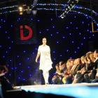 Front-row audience members  watch a model  on the catwalk at the iD Dunedin Fashion Show on...