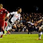 Fulham's Clint Dempsey (C) celebrates scoring against Liverpool as team mate Andrew Johnson (R)...