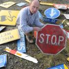Fulton Hogan maintenance manager Dean Scott with some of the damaged signs from Otago's state...