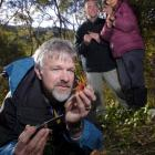 Dr Peter Buchanan (at left), a Landcare Research science team leader, holds a flower-shaped...
