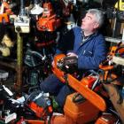 G&J Swann Saw and Mower small motor mechanic John Ferguson sits among a growing pile of returned...