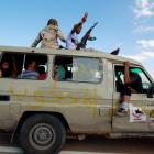 Gaddafi loyalists are captured by anti-Gaddafi fighters in a vehicle, in the centre of Sirte,...