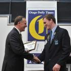 Gavin Stark is presented with his certificate by Prime Minister John Key at the 2013 Class Act...