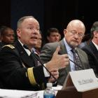 General Keith Alexander (second from left), director of the National Security Agency (NSA),...