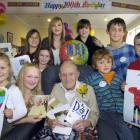 George McKnight celebrates his 100th birthday with great-grandchildren, from left, Farrin Quin (6...