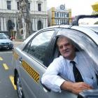 George Morrison says he will continue driving a taxi if made a city councillor so he can maintain...