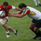 Georgia's Malkhaz Urjukashvili (left) fends off South African Kings' Clint Newland during an IRB...