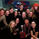 Georgie Salter shows off the Caltex Cup, surrounded by the members of the Otago netball team, on...