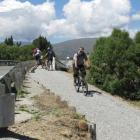 German cycle tourist Felix Stenschke exits the Albert Town bridge on the upgraded cycle and...
