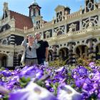 German tourists Julia Ballreich and Alexander Franze take photographs at the Dunedin Railway...