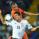 Germany's Mario Gomez (front) vies for the ball with Netherlands' John Heitinga during their...