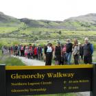 Glenorchy residents try  the newly opened Lagoon Boardwalk Track yesterday. Photo by Olivia...