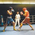 Gloves up and toe to toe: Gary Waines (left), of Christchurch, and Renata Karena, of Gore, during...