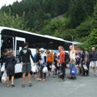 Godzone competitors line up for the bus on Saturday morning in Queenstown not knowing what the...