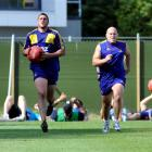 Going through a training exercise at Logan Park yesterday are (from left)  Telusa Veainu, Daniel...